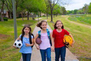bigstock-Children-kid-girls-walking-to--46442662