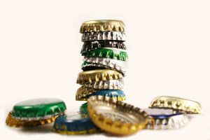 bigstock-Tumbling-Beer-Caps-413711