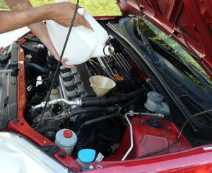 bigstock-Adding-Motor-Oil-To-Car-22372964