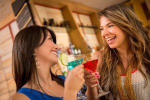 bigstock-Two-women-having-drinks-at-the-45150049