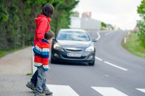 bigstock-Car-stopped-for-pedestrian-42758428
